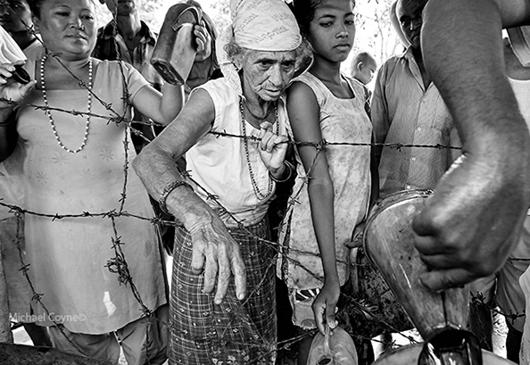 Bhutanese queue for water at a refugee camp - Nepal : michael coyne documentary photographer and photojournalist