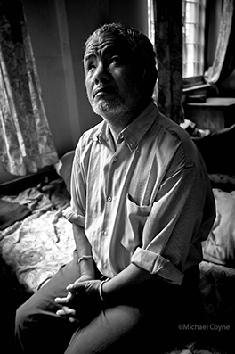 Homeless blind man living in a JSS Hostel - Nepal : michael coyne documentary photographer and photojournalist