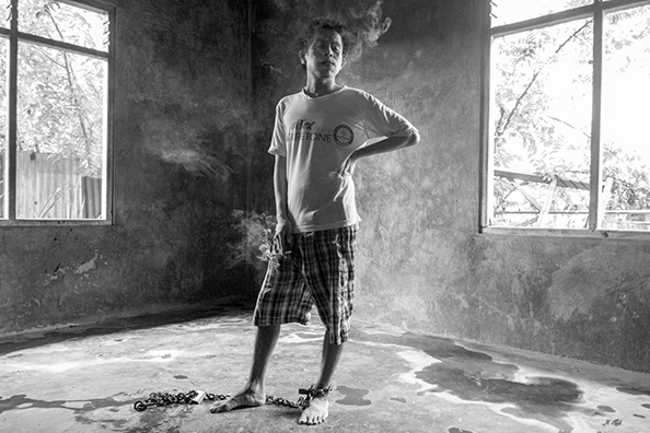 michael coyne documentary photographer and photojournalist: Man with mental health issues - Indonesia