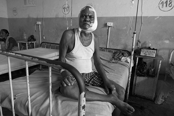 Bhutanese refugee in hospital - Nepal : michael coyne documentary photographer and photojournalist