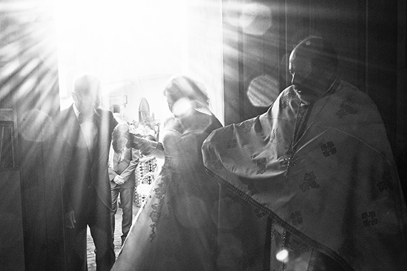 michael coyne documentary photographer and photojournalist: Bride enters a church - Greece