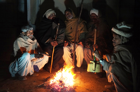 Night watchmen in a christian village - Pakistan : michael coyne documentary photographer and photojournalist