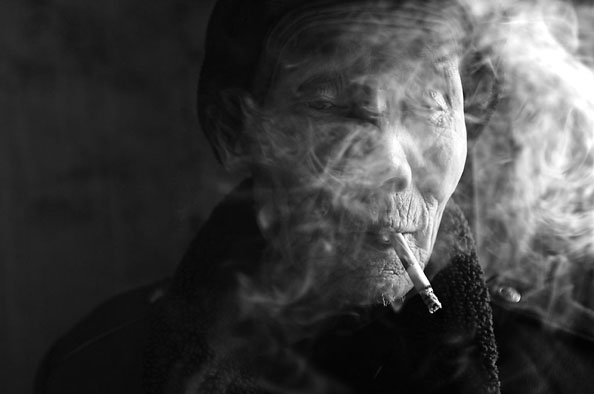 michael coyne documentary photographer and photojournalist: Smoker - China